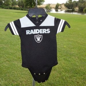 Like new toddler Oakland Raiders onesie I guess 24